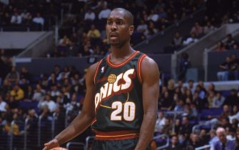 8 Dec 2000:  Gary Payton #20 of the Seattle SuperSonics stands with the ball during the game against the Los Angeles Lakers at the STAPLES Center in Los Angeles, California. The SuperSonics defeated the Lakers 103-95.    NOTE TO USER: It is expressly understood that the only rights Allsport are offering to license in this Photograph are one-time, non-exclusive editorial rights. No advertising or commercial uses of any kind may be made of Allsport photos. User acknowledges that it is aware that Allsport is an editorial sports agency and that NO RELEASES OF ANY TYPE ARE OBTAINED from the subjects contained in the photographs.Mandatory Credit: Donald Miralle  /Allsport