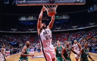 EAST RUTHERFORD - 1997: Jayson Williams #55 of the New Jersey Nets dunks against the Boston Celtics circa 1997 at the Contintental Airlines Arena in East Rutherford, New Jersey. NOTE TO USER: User expressly acknowledges and agrees that, by downloading and or using this photograph, User is consenting to the terms and conditions of the Getty Images License Agreement. Mandatory Copyright Notice: Copyright 1997 NBAE (Photo by Chuck Solomon/NBAE via Getty Images)