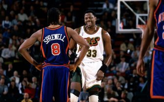 SEATTLE - 2001: Patrick Ewing #33 of the Seattle SuperSonics talks with Latrell Sprewell #8 of the New York Knicks during an NBA game at the Key Arena in Seattle, Washington.    NOTE TO USER: User expressly acknowledges  and agrees that, by downloading and or using this  photograph, User is consenting to the terms and conditions of the Getty Images License Agreement. (Photo by Jeff Reinking/ NBAE/ Getty Images)