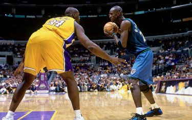 LOS ANGELES - 2000:  Kevin Garnett #21 of the Minnesota Timberwolves makes a move against Shaquille O'Neal #34 of the Los Angeles Lakers during a 2000 NBA game at the Staples Center in Los Angeles, California. NOTE TO USER: User expressly acknowledges that, by downloading and or using this photograph, User is consenting to the terms and conditions of the Getty Images License agreement. Mandatory Copyright Notice: Copyright 2000 NBAE (Photo by Ron Modra/NBAE via Getty Images)