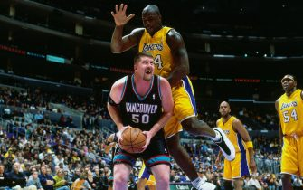 LOS ANGELES, CA - JAN 15:  Bryant Reeves #50 of the Vancouver Grizzlies drives against Shaquille O'Neal #34 of the Los Angeles Lakers on January 15, 2001 at Staples Center in Los Angeles, CA. NOTE TO USER: User expressly acknowledges and agrees that, by downloading and/or using this photograph, user is consenting to the terms and conditions of the Getty Images License Agreement. Mandatory Copyright Notice: Copyright 2001 NBAE (Photo by Robert Mora/NBAE via Getty Images)