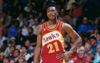 ATLANTA - 1990: Dominique Wilkins #21 of the Atlanta Hawks stands during a game played circa 1990 at the Omni  in Atlanta, Georgia. NOTE TO USER: User expressly acknowledges and agrees that, by downloading and or using this photograph, User is consenting to the terms and conditions of the Getty Images License Agreement. Mandatory Copyright Notice: Copyright 1990 NBAE (Photo by Scott Cunningham/NBAE via Getty Images)