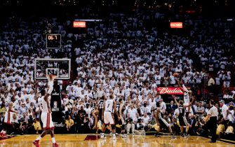 MIAMI, FL - JUNE 18: Ray Allen #34 of the Miami Heat hits a three-point shot to tie the score and send the San Antonio Spurs into overtime in Game Six of the 2013 NBA Finals on June 18, 2013 at American Airlines Arena in Miami, Florida. NOTE TO USER: User expressly acknowledges and agrees that, by downloading and or using this photograph, User is consenting to the terms and conditions of the Getty Images License Agreement. Mandatory Copyright Notice: Copyright 2013 NBAE (Photo by Nathaniel S. Butler/NBAE via Getty Images)