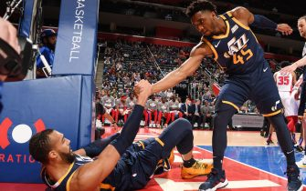 DETROIT, MI - MARCH 7: Donovan Mitchell #45 of the Utah Jazz helps Rudy Gobert #27 of the Utah Jazz from the floor on March 7, 2020 at Little Caesars Arena in Detroit, Michigan. NOTE TO USER: User expressly acknowledges and agrees that, by downloading and/or using this photograph, User is consenting to the terms and conditions of the Getty Images License Agreement. Mandatory Copyright Notice: Copyright 2020 NBAE (Photo by Chris Schwegler/NBAE via Getty Images)