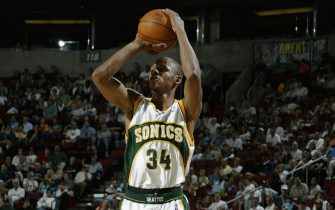 SEATTLE - APRIL 10:  Ray Allen #34 of the Seattle Sonics shoots against the Dallas Mavericks during the game at Key Arena on April 10, 2004 in Seattle, Washington.  The Sonics won 119-99.  NOTE TO USER: User expressly acknowledges and agrees that, by downloading and/or using this Photograph, User is consenting to the terms and conditions of the Getty Images License Agreement.  (Photo by Jeff Reinking/NBAE via Getty Images)