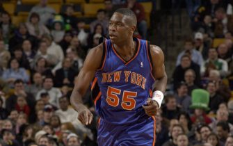 BOSTON - JANUARY 30:  Dikembe Mutombo #55 of the New York Knicks runs upcourt during the game against the Boston Celtics at the Fleet Center on January 30, 2004 in Boston, Massachusetts.  The Knicks won 92-74.  NOTE TO USER: User expressly acknowledges and agrees that, by downloading and/or using this Photograph, User is consenting to the terms and conditions of the Getty Images License Agreement.  (Photo by Brian Babineau/NBAE via Getty Images)