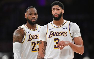 LOS ANGELES, CA - JANUARY 01: LeBron James #23 and Anthony Davis #3 of the Los Angeles Lakers while playing the Phoenix Suns at Staples Center on January 1, 2020 in Los Angeles, California. NOTE TO USER: User expressly acknowledges and agrees that, by downloading and/or using this photograph, user is consenting to the terms and conditions of the Getty Images License Agreement. Lakers won 117 to 107. (Photo by John McCoy/Getty Images)