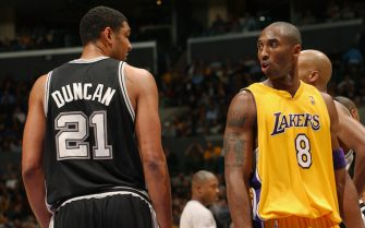 LOS ANGELES - NOVEMBER 5:  Kobe Bryant #8 of the Los Angeles Lakers exchanges words with Tim Duncan #21 of the San Antonio Spurs at the Staples Center on November 5, 2004 in Los Angeles, California. The Spurs won 105-96. NOTE TO USER: User expressly acknowledges and agrees that, by downloading and/or using this photograph, User is consenting to the terms and conditions of Getty Images License Agreement. Mandatory Copyright Notice: Copyright 2004 NBAE  (Photo by Andrew D. Bernstein/NBAE via Getty Images)