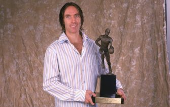 PHOENIX - MAY 8:  Steve Nash #13 of the Phoenix Suns poses with the Maurice Podoloff Trophy for the NBA's Most Valuable Player for the 2004-2005 season at America West Arena on May 8, 2005 in Phoenix, Arizona.  NOTE TO USER:  User expressly acknowledges and agrees that, by downloading and/or using this Photograph, user is consenting to the terms and conditions of the Getty Images License Agreement. Mandatory Copyright Notice: Copyright 2005 NBAE (Photo by Barry Gossage/NBAE via Getty Images)