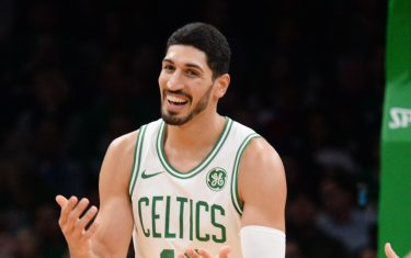 BOSTON, MA - OCTOBER 13: Enes Kanter #11 of the Boston Celtics reacts after a foul call in the third quarter against the Cleveland Cavaliers at TD Garden on October 13, 2019 in Boston, Massachusetts. NOTE TO USER: User expressly acknowledges and agrees that, by downloading and or using this photograph, User is consenting to the terms and conditions of the Getty Images License Agreement. (Photo by Kathryn Riley/Getty Images)