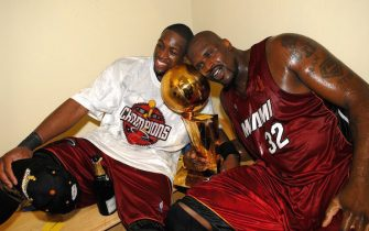 DALLAS - JUNE 20:  Dwyane Wade #3 and Shaquille O'Neal #32 of the Miami Heat celebrate with the Larry O'Brien Championship trophy after their Game Six victory of the 2006 NBA Finals against the Dallas Mavericks on June 20, 2006 at American Airlines Center in Dallas, Texas. The Heat defeated the Mavericks 95-92 to win their first NBA Championship.  NOTE TO USER: User expressly acknowledges and agrees that, by downloading and or using this photograph, User is consenting to the terms and conditions of the Getty Images License Agreement. Mandatory Copyright Notice: Copyright 2006 NBAE  (Photo by Andrew D. Bernstein/NBAE via Getty Images)