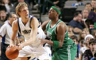 DALLAS - DECEMBER 10:  Dirk Nowitzki #41 of the Dallas Mavericks is defended by Paul Pierce #34 of the Boston Celtics during the game at American Airlines Arena on December 10, 2005 in Dallas, Texas.  The Mavericks won 103-94.  NOTE TO USER: User expressly acknowledges and agrees that, by downloading and/or using this Photograph, user is consenting to the terms and conditions of the Getty Images License Agreement. Mandatory Copyright Notice: Copyright 2005 NBAE  (Photo by Glenn James/NBAE via Getty Images)