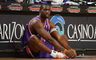 PHOENIX - MARCH 3:  Tim Thomas #2 of the Phoenix Suns waits at the scorer's table against the Orlando Magic on March 3, 2006 at US Airways Center in Phoenix, Arizona. The Suns won 123-118. NOTE TO USER: User expressly acknowledges and agrees that, by downloading and/or using this Photograph, user is consenting to the terms and conditions of the Getty Images License Agreement. Mandatory Copyright Notice: Copyright 2006 NBAE   (Photo by Barry Gossage/NBAE via Getty Images) *** Local Caption *** Tim Thomas