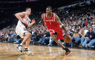 PORTLAND, OR - DECEMBER 11:  Tracy McGrady #1 of the Houston Rockets drives the ballagainst the Portland Trail Blazers at The Rose Garden on December 11, 2005 in Portland, Oregon. The Rockets won 100-84. NOTE TO USER: User expressly acknowledges and agrees that, by downloading and/or using this Photograph, user is consenting to the terms and conditions of the Getty Images License Agreement. Mandatory Copyright Notice: Copyright 2005 NBAE (Photo by Sam Forencich/NBAE via Getty Images) *** Local Caption *** Tracy McGrady