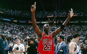SALT LAKE CITY - JUNE 14:  Michael Jordan #23 of the Chicago Bulls raises his hands to signal a 6th championship as he leaves the court after winning the NBA Championpship against the Utah at the Delta Center on June 14, 1998 in Salt Lake City, Utah. The Bulls won 87-86.  NOTE TO USER: User expressly acknowledges  and agrees that, by downloading and or using this  photograph, User is consenting to the terms and conditions of the Getty Images License Agreement. (Photo by Nathaniel S. Butler/ NBAE via Getty Images)