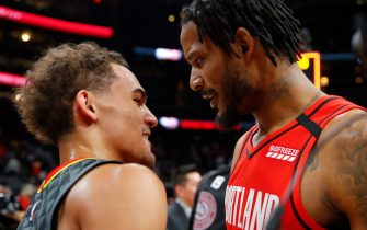 ATLANTA, GA - FEBRUARY 29: Trae Young #11 of the Atlanta Hawks and Trevor Ariza #8 of the Portland Trail Blazers hug it out at the conclusion of an NBA game at State Farm Arena on February 29, 2020 in Atlanta, Georgia. NOTE TO USER: User expressly acknowledges and agrees that, by downloading and/or using this photograph, user is consenting to the terms and conditions of the Getty Images License Agreement. (Photo by Todd Kirkland/Getty Images) *** Local Caption *** Trae Young; Trevor Ariza