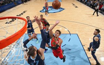 MEMPHIS, TN - MARCH 7: Trae Young #11 of the Atlanta Hawks shoots the ball during the game against the Memphis Grizzlies on March 7, 2020 at FedExForum in Memphis, Tennessee. NOTE TO USER: User expressly acknowledges and agrees that, by downloading and or using this photograph, User is consenting to the terms and conditions of the Getty Images License Agreement. Mandatory Copyright Notice: Copyright 2020 NBAE (Photo by Joe Murphy/NBAE via Getty Images)