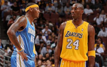 ANAHEIM, CA - OCTOBER 22:  Carmelo Anthony #15 of the Denver Nuggets talks to Kobe Bryant #24 of the Los Angeles Lakers during the preseason game on October 22, 2009 at Honda Center in Anaheim, California.  The Lakers won 106-89.  NOTE TO USER: User expressly acknowledges and agrees that, by downloading and/or using this Photograph, user is consenting to the terms and conditions of the Getty Images License Agreement. Mandatory Copyright Notice: Copyright 2009 NBAE (Photo by Andrew D. Bernstein/NBAE via Getty Images)