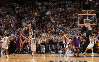 SAN ANTONIO - MAY 13:  Derek Fisher # 2 of the Los Angeles Lakers shoots and makes the game-winning shot over Emanuel Ginobili #20 of the San Antonio Spurs at the buzzer in Game five of the Western Conference Semifinals during the 2004 NBA Playoffs May 13, 2004 at the SBC Center in San Antonio, Texas.  NOTE TO USER: User expressly acknowledges and agrees that, by downloading and or using this photograph, User is consenting to the terms and conditions of the Getty Images License Agreement.  Mandatory Copyright Notice: Copyright 2004 NBAE  (Photo by Andrew D. Bernstein/NBAE via Getty Images)