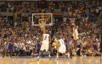 LOS ANGELES - APRIL 30:  Kobe Bryant #8 of the Los Angeles Lakers shoots the buzzer beating game winning shot in overtime against the Phoenix Suns in game four of the Western Conference Quarterfinals during the 2006 NBA Playoffs at Staples Center on April 30, 2006 in Los Angeles, California. NOTE TO USER: User expressly acknowledges and agrees that, by downloading and or using this photograph, User is consenting to the terms and conditions of the Getty Images License Agreement. Mandatory Copyright Notice: Copyright 2006 NBAE (Photo by Andrew D. Bernstein/NBAE via Getty Images)