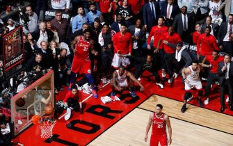 TORONTO, CANADA - MAY 12: Kawhi Leonard #2 of the Toronto Raptors hits the game winning shot against the Philadelphia 76ers during Game Seven of the Eastern Conference Semifinals of the 2019 NBA Playoffs on May 12, 2019 at the Scotiabank Arena in Toronto, Ontario, Canada.  NOTE TO USER: User expressly acknowledges and agrees that, by downloading and or using this Photograph, user is consenting to the terms and conditions of the Getty Images License Agreement.  Mandatory Copyright Notice: Copyright 2019 NBAE (Photo by Mark Blinch/NBAE via Getty Images)
