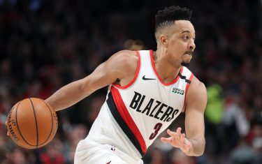 PORTLAND, OREGON - FEBRUARY 06: CJ McCollum #3 of the Portland Trail Blazers dribbles with the ball in the third quarter against the San Antonio Spurs during their game at Moda Center on February 06, 2020 in Portland, Oregon. NOTE TO USER: User expressly acknowledges and agrees that, by downloading and or using this photograph, User is consenting to the terms and conditions of the Getty Images License Agreement. (Photo by Abbie Parr/Getty Images)