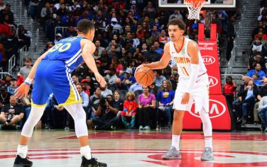 ATLANTA, GA - DECEMBER 3: Trae Young #11 of the Atlanta Hawks dribbles the ball during the game against Stephen Curry #30 of the Golden State Warriors on December 3, 2018 at State Farm Arena in Atlanta, Georgia.  NOTE TO USER: User expressly acknowledges and agrees that, by downloading and/or using this Photograph, user is consenting to the terms and conditions of the Getty Images License Agreement. Mandatory Copyright Notice: Copyright 2018 NBAE (Photo by Scott Cunningham/NBAE via Getty Images)