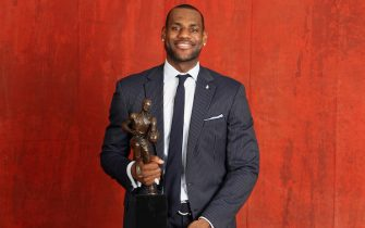 AKRON - MAY 4: LeBron James poses with the 2008-2009 MVP Trophy on Monday May 4th, 2009 in Akron, Ohio. NOTE TO USER: User expressly acknowledges and agrees that, by downloading and or using this photograph, User is consenting to the terms and conditions of the Getty Images License Agreement. Mandatory Copyright Notice: Copyright 2009 NBAE (Photo by Nathaniel S. Butler/NBAE via Getty Images) *** Local Caption ***LeBron James