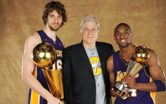 ORLANDO, FL - JUNE 14: Pau Gasol #16, Phil Jackson and Kobe Bryant #24 of the Los Angeles Lakers pose for a portrait after defeating the Orlando Magic in Game Five of the 2009 NBA Finals at Amway Arena on June 14, 2009 in Orlando, Florida. The Los Angeles Lakers defeated the Orlando Magic 99-86. NOTE TO USER: User expressly acknowledges and agrees that, by downloading and or using this photograph, User is consenting to the terms and conditions of the Getty Images License Agreement. Mandatory Credit: 2009 NBAE  (Photo by Andrew D. Bernstein/NBAE via Getty Images) *** Local Caption *** Pau Gasol; Phil Jackson; Kobe Bryant
