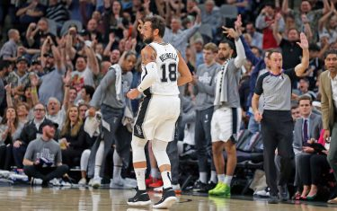 SAN ANTONIO, TX - FEBRUARY 26:  Fans and bench applaud after a three by Marco Belinelli #18 of the San Antonio Spurs during first half action at AT&T Center on February  26, 2020 in San Antonio, Texas.  San Antonio Spurs defeated the Dallas Mavericks 119-109. NOTE TO USER: User expressly acknowledges and agrees that , by downloading and or using this photograph, User is consenting to the terms and conditions of the Getty Images License Agreement. (Photo by Ronald Cortes/Getty Images)