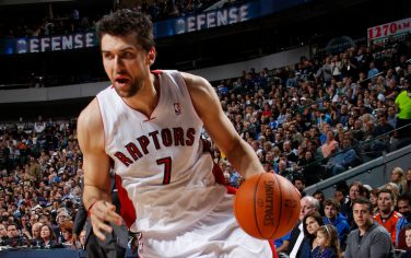 DALLAS, TX - DECEMBER 30: Andrea Bargnani #7 of the Toronto Raptors drives against the Dallas Mavericks on December 30, 2011 at the American Airlines Center in Dallas, Texas. NOTE TO USER: User expressly acknowledges and agrees that, by downloading and or using this photograph, User is consenting to the terms and conditions of the Getty Images License Agreement. Mandatory Copyright Notice: Copyright 2011 NBAE (Photo by Glenn James/NBAE via Getty Images)