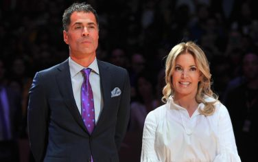 LOS ANGELES, CA - DECEMBER 18: Rob Pelinka and Jeanie Buss attend Kobe Bryant's jersey retirement ceremony during a basketball game between the Los Angeles Lakers and the Golden State Warriors at Staples Center on December 18, 2017 in Los Angeles, California.  (Photo by Allen Berezovsky/Getty Images)