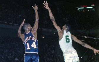 BOSTON - 1964:  Oscar Robertson #14 of the Cincinnati Royals shoots a jump shot over Bill Russell #6 of the Boston Celtics during a game played in 1964 at the Boston Garden in Boston, Massachusetts. NOTE TO USER: User expressly acknowledges and agrees that, by downloading and or using this photograph, User is consenting to the terms and conditions of the Getty Images License Agreement. Mandatory Copyright Notice: Copyright 1964 NBAE (Photo by Dick Raphael/NBAE via Getty Images)