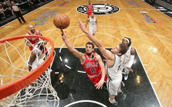NEW YORK, NY - MAY 4: Marco Belinelli #8 of the Chicago Bulls shoots against Brook Lopez #11 of the Brooklyn Nets during the Game Seven of the Eastern Conference Quarterfinals during the 2013 NBA Playoffs at the Barclays Center on May 4, 2013 in the Brooklyn borough of New York City.  NOTE TO USER: User expressly acknowledges and agrees that, by downloading and/or using this Photograph, user is consenting to the terms and conditions of the Getty Images License Agreement. Mandatory Copyright Notice: Copyright 2013 NBAE (Photo by Nathaniel S. Butler/NBAE via Getty Images)
