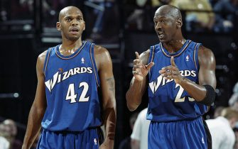 PORTLAND, OR - MARCH 25:  Michael Jordan #23 of the Washington Wizards talks with teammate Jerry Stackhouse #42 during the NBA game against the Portland Trail Blazers at The Rose Garden on March 25, 2003 in Portland, Oregon.  The Wizards won 95-91.  NOTE TO USER:  User expressly acknowledges and agrees that, by downloading and or using this Photograph, User is consenting to the terms and conditions of the Getty Images License Agreement.  Mandatory Copyright Notice:  Copyright 2003 NBAE  (Photo by Sam Forencich/NBAE via Getty Images)