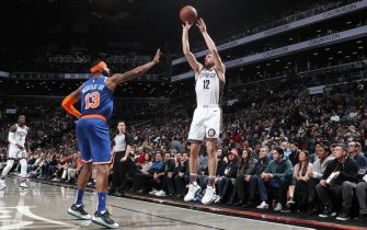 BROOKLYN, NY - DECEMBER 26: Joe Harris #12 of the Brooklyn Nets shoots a three-pointer against the New York Knicks on December 26, 2019 at Barclays Center in Brooklyn, New York. NOTE TO USER: User expressly acknowledges and agrees that, by downloading and or using this Photograph, user is consenting to the terms and conditions of the Getty Images License Agreement. Mandatory Copyright Notice: Copyright 2019 NBAE (Photo by Nathaniel S. Butler/NBAE via Getty Images)