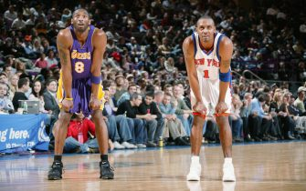 NEW YORK - FEBRUARY 28:  Kobe Bryant #8 of the Los Angeles Lakers stands on the court with Anfernee Hardaway #1 of the New York Knicks during the game of the New York Knicks on February 28, 2005 at Madison Square Garden in New York, New York. The Knicks won 117-115 in overtime.  NOTE TO USER: User expressly acknowledges and agrees that, by downloading and/or using this Photograph, user is consenting to the terms and conditions of the Getty Images License Agreement. Mandatory Copyright Notice: Copyright 2005 NBAE  (Photo by Nathaniel S. Butler/NBAE via Getty Images) *** Local Caption *** Kobe Bryant;Anfernee Hardaway
