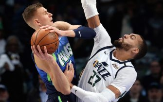 DALLAS, TEXAS - FEBRUARY 10:  Kristaps Porzingis #6 of the Dallas Mavericks takes a shot against Rudy Gobert #27 of the Utah Jazz in the first half at American Airlines Center on February 10, 2020 in Dallas, Texas.  NOTE TO USER: User expressly acknowledges and agrees that, by downloading and or using this photograph, User is consenting to the terms and conditions of the Getty Images License Agreement. (Photo by Ronald Martinez/Getty Images)