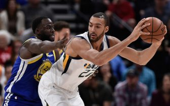 SALT LAKE CITY, UT - OCTOBER 19: Draymond Green #23 of the Golden State Warriors defends against Rudy Gobert #27 of the Utah Jazz in the first half of a NBA game at Vivint Smart Home Arena on October 19, 2018 in Salt Lake City, Utah. NOTE TO USER: User expressly acknowledges and agrees that, by downloading and or using this photograph, User is consenting to the terms and conditions of the Getty Images License Agreement. (Photo by Gene Sweeney Jr./Getty Images)