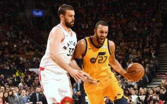 TORONTO, CANADA - DECEMBER 1: Rudy Gobert #27 of the Utah Jazz handles the ball during a game against the Toronto Raptors on December 1, 2019 at the Scotiabank Arena in Toronto, Ontario, Canada.  NOTE TO USER: User expressly acknowledges and agrees that, by downloading and or using this Photograph, user is consenting to the terms and conditions of the Getty Images License Agreement.  Mandatory Copyright Notice: Copyright 2019 NBAE (Photo by Ron Turenne/NBAE via Getty Images)