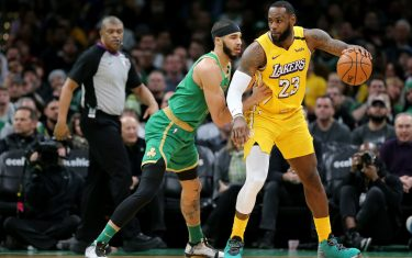 BOSTON, MASSACHUSETTS - JANUARY 20: Jayson Tatum #0 of the Boston Celtics defends LeBron James #23 of the Los Angeles Lakers at TD Garden on January 20, 2020 in Boston, Massachusetts. The Celtics defeat the Lakers 139-107.  (Photo by Maddie Meyer/Getty Images)