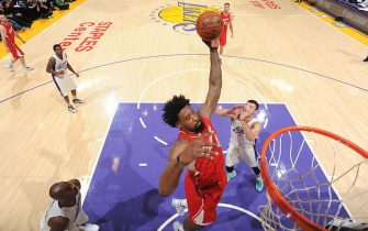 LOS ANGELES, CA - DECEMBER 25:  DeAndre Jordan #6 of the Los Angeles Clippers grabs the rebound against the Los Angeles Lakers at STAPLES Center on December 25, 2015 in Los Angeles, California. NOTE TO USER: User expressly acknowledges and agrees that, by downloading and/or using this Photograph, user is consenting to the terms and conditions of the Getty Images License Agreement. Mandatory Copyright Notice: Copyright 2015 NBAE (Photo by Andrew D. Bernstein/NBAE via Getty Images)