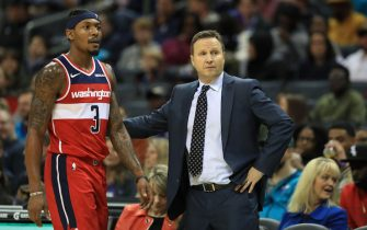 CHARLOTTE, NORTH CAROLINA - DECEMBER 10: Bradley Beal #3 of the Washington Wizards walks off the court alongside head coach Scott Brooks during their game against the Charlotte Hornets at Spectrum Center on December 10, 2019 in Charlotte, North Carolina. NOTE TO USER: User expressly acknowledges and agrees that, by downloading and or using this photograph, User is consenting to the terms and conditions of the Getty Images License Agreement. (Photo by Streeter Lecka/Getty Images)