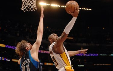 LOS ANGELES - MARCH 2:  Kobe Bryant #24 of the Los Angeles Lakers goes to the basket against Dirk Nowitzki #41 of the Dallas Mavericks at Staples Center March 2, 2008 in Los Angeles, California. NOTE TO USER: User expressly acknowledges and agrees that, by downloading and/or using this Photograph, user is consenting to the terms and conditions of the Getty Images License Agreement. Mandatory Copyright Notice: Copyright 2008 NBAE (Photo by Noah Graham/NBAE via Getty Images)