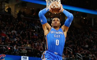 CLEVELAND, OH - JANUARY 20:  Russell Westbrook #0 of the Oklahoma City Thunder dunks the ball during the first quarter of the game against the Cleveland Cavaliers at Quicken Loans Arena on January 20, 2018 in Cleveland, Ohio. NOTE TO USER: User expressly acknowledges and agrees that, by downloading and or using this photograph, User is consenting to the terms and conditions of the Getty Images License Agreement. (Photo by Kirk Irwin/Getty Images)
