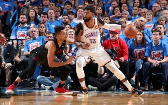 OKLAHOMA CITY, OK - APRIL 21: Paul George #13 of the Oklahoma City Thunder handles the ball against the Portland Trail Blazers during Game Four of Round One of the 2019 NBA Playoffs on April 21, 2019 at Chesapeake Energy Arena in Oklahoma City, Oklahoma. NOTE TO USER: User expressly acknowledges and agrees that, by downloading and/or using this photograph, user is consenting to the terms and conditions of the Getty Images License Agreement. Mandatory Copyright Notice: Copyright 2019 NBAE (Photo by Joe Murphy/NBAE via Getty Images)