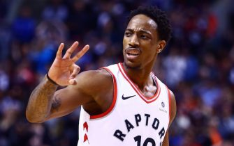 TORONTO, ON - JANUARY 01:  DeMar DeRozan #10 of the Toronto Raptors signals to an official during the second half of an NBA game against the Milwaukee Bucks at Air Canada Centre on January 1, 2018 in Toronto, Canada.  NOTE TO USER: User expressly acknowledges and agrees that, by downloading and or using this photograph, User is consenting to the terms and conditions of the Getty Images License Agreement.  (Photo by Vaughn Ridley/Getty Images)