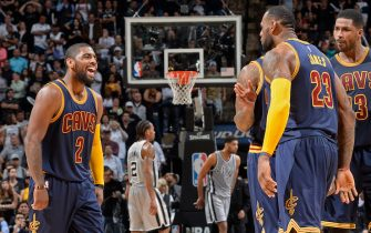 SAN ANTONIO - MARCH 12:  LeBron James #23 and Kyrie Irving #2 of the Cleveland Cavaliers celebrate during the game against the San Antonio Spurs at the AT&T Center on March 12, 2015 in San Antonio, Texas. NOTE TO USER: User expressly acknowledges and agrees that, by downloading and or using this photograph, user is consenting to the terms and conditions of the Getty Images License Agreement. Mandatory Copyright Notice: Copyright 2015 NBAE (Photos by D. Clarke Evans/NBAE via Getty Images)