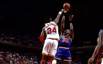 HOUSTON - JUNE 22:  Patrick Ewing #33of the New York Knicks shoots against Hakeem Olajuwon #34 of the Houston Rockets during Game Seven of the 1994 NBA Finals at the Summit on June 22, 1994 in Houston, Texas.  NOTE TO USER: User expressly acknowledges that, by downloading and or using this photograph, User is consenting to the terms and conditions of the Getty Images License agreement. Mandatory Copyright Notice: Copyright 1994 NBAE (Photo by Andrew D. Bernstein/NBAE via Getty Images)
