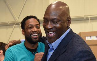 CHARLOTTE, NC - FEBRUARY 15:  Dwyane Wade #3 of the Miami Heat and Michael Jordan participate during the 2019 NBA Cares All-Star Day of Service at Second Harvest Food bank of Metrolina on February 15, 2019 in Charlotte, North Carolina. NOTE TO USER: User expressly acknowledges and agrees that, by downloading and or using this photograph, User is consenting to the terms and conditions of the Getty Images License Agreement. Mandatory Copyright Notice: Copyright 2019 NBAE (Photo by Andrew D. Bernstein/NBAE via Getty Images)